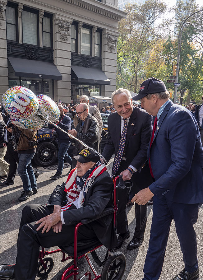 Senator Schumer wheeling one of America's Oldest Veterans at the 2019 Veterans Day Parade